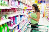 Woman buys washing powder — Stock Photo