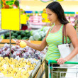 Woman chooses pears in the store — Stock Photo