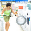 Woman buying a washing machine — Stock Photo
