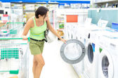 Woman buying a washing machine — Stock Photo