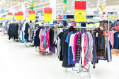Clothes sale in a supermarket — Stock Photo