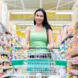 Stock Photo: Womshopping at supermarket