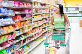 Woman shopping at the supermarket — Foto de Stock