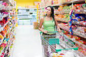 Woman shopping at the supermarket — Stock Photo