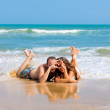 Couple lying on beach — Stock Photo