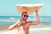 Surfer with board — Stock Photo