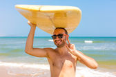 Surfer showing victory sign — Stock Photo