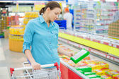 Woman and food labelling — Stock Photo