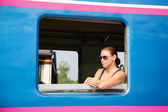 Young woman passenger looking trough window — Stock Photo