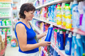 Woman buys washing powder — Stock Photo