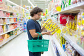 Man checking food labelling — Stock Photo