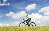 Woman riding bicycle — Stock Photo