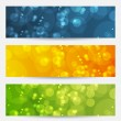 Set of abstract backgrounds with bokeh effect - Stock Vector