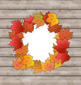 Autumn leaves maple with copy space, wooden texture — Stock Vector