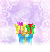 Set Christmas gift boxes on light background — Stock Vector