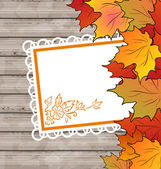 Autumn card with leaves maple, wooden texture — Stock Vector