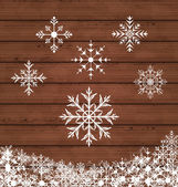 Set snowflakes on wooden texture — Stock Vector