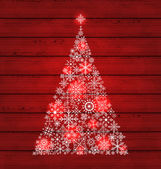 Christmas fir made of snowflakes on wooden background — Stock Vector