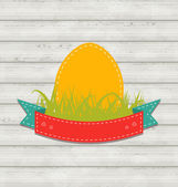 Vintage label with Easter egg on wooden background — Vettoriale Stock