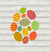 Easter ornamental eggs on wooden background — Stock Vector