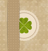 Vintage card with four-leaf clover for St. Patrick's Day — Stock Vector