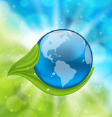 Planet Earth with green leaves — Stock Vector