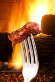 Steak on a fork. — Stock Photo