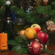 Stock Photo: Candle and christmas-tree decorations