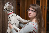 Dalmatian and girl — Stock Photo