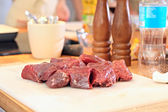 Raw meat on the board — Stock Photo