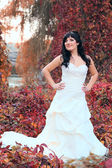 Girl in a weeding dress in a park — Stock Photo
