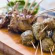 Roasted lamb meat on the big table — Stock Photo