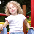 Young girl  slide — Stock Photo
