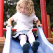Young girl  slide - Stock Photo