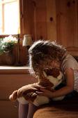 Sad little girl hugging teddy bear — Stock Photo