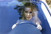 Frightened woman in car — Stock Photo