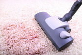 Vacuuming very dirty white carpet — Stock Photo