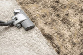 Vacuuming very dirty carpet — Stock Photo