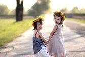 Two girls with wreaths on the head — Stock Photo