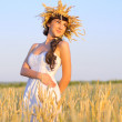 Girl on wheat field — Stock Photo #12691830