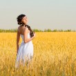 Girl on wheat field — Stock Photo #12691874
