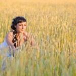 Girl on wheat field — Stock Photo #12691922