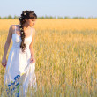Girl on wheat field — Stock Photo #12691978