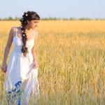 Girl on wheat field — Stock Photo #12691978