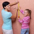 Woman with her daughter doing home repair — Stock Photo