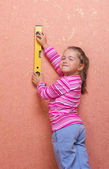 Little girl with measurement level — Stock Photo