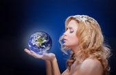 Frozen girl holding earth globe (west hemispere) — Stock Photo