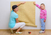 Woman and girl doing home repair — Stock Photo