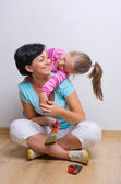 Young smiling woman and little girl — Stock Photo