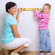 Woman and girl with measurement level — Stock Photo #14246043